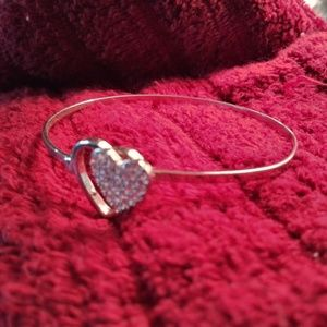 Interlocking heart bangle bracelet